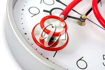 Royalty Free Photo of a Stethoscope on a Clock