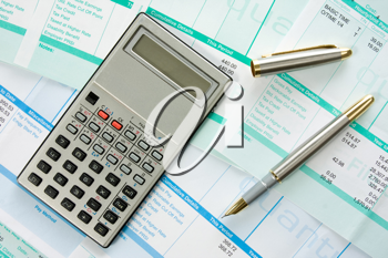 Royalty Free Photo of a Calculator on Payroll Documents