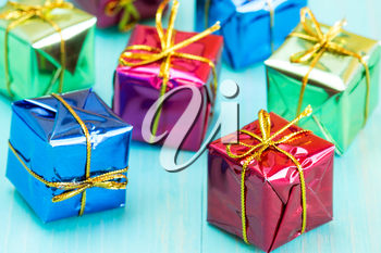 Close up of a small gift boxes on blue wood background