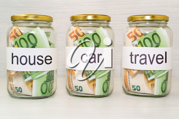 Saving money into glass jar for future investment