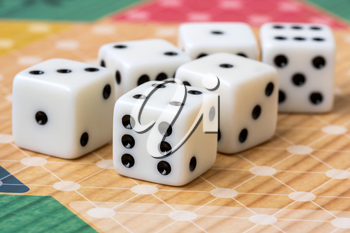 Six white dice on board game background