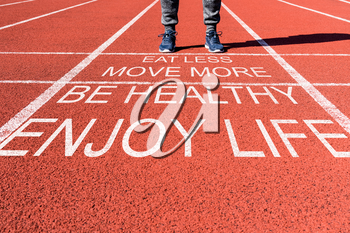 Health and motivation concept.Runner feet on the  starting line for new life