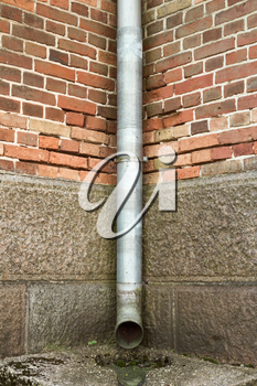 Vintage brick wall texture with drainpipe
