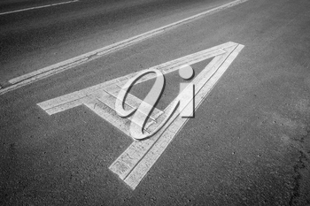 Letter A on asphalt road. Black and white photograph