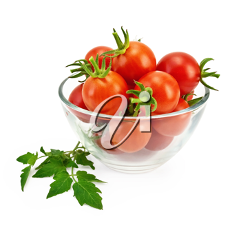 Small red tomatoes in a glass container with a green leaf isolated on white background