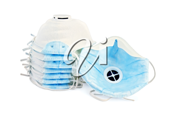 A stack of white and one detached disposable respirators with blue detail isolated on white background