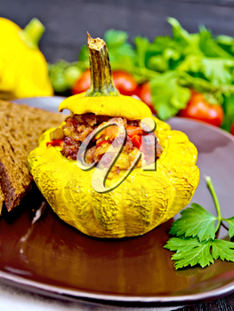 Squash yellow stuffed with meat, tomatoes and peppers, bread in a brown plate, tomatoes, parsley on a dark wooden board