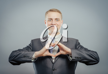 Happy businessman with love gesture