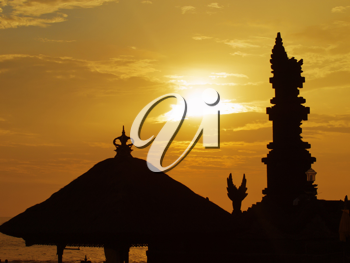 Traditional balinese roof and pillar silhouette at sunset, Tanah Lot, Bali, Indonesia