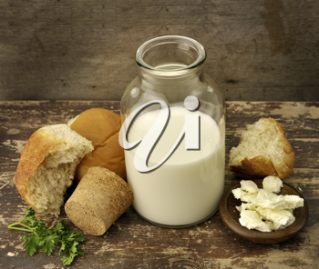 Royalty Free Photo of a Bottle of Milk and Bread