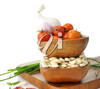 Royalty Free Photo of Baby Lima Beans, Tomatoes And Spices In Wooden Bowls