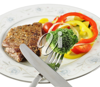a steak and fresh vegetables, close up