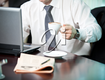Businessman with a cup of coffee, close-up