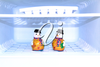 Royalty Free Clipart Image of Snowmen in a Freezer