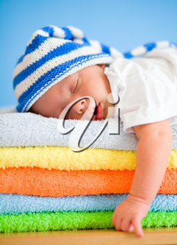 Royalty Free Photo of a Baby Sleeping on Towels