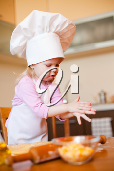 Royalty Free Photo of a Little Girl Baking