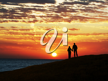 Royalty Free Photo of a Couple at Sunset