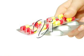 pills capsules of antibiotic in hand isolated on white