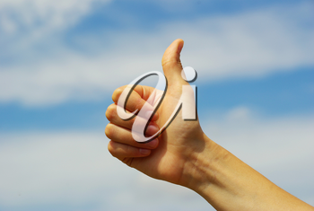 Womans hand with thumb up ok signal