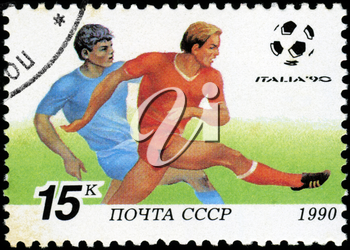 USSR - CIRCA 1990: a stamp printed by USSR shows football players. World football cup in Italy, series, circa 1990