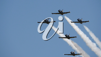 Flight of the aerobatic group Rus in the sky.