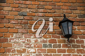 lamp on the old wall with red bricks