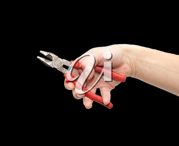 pliers in hand on a black background