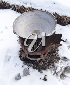 large cauldron outdoors in winter