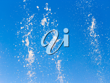 water splashing from the fountain in the background of blue sky