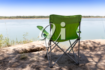 chair on river bank