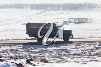 truck driving on a road in winter