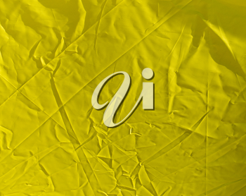 wrinkled yellow cloth as background