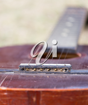 Guitar lying on the grass on the nature