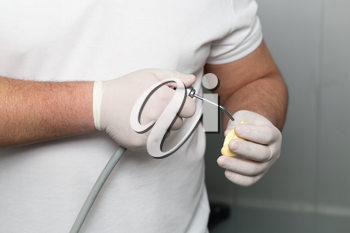 doctor makes a plastic prosthetic dentistry