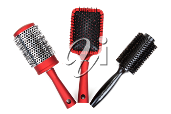 Royalty Free Photo of Three Hairbrushes