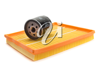 Set of two air filters and oil filter isolated on white.