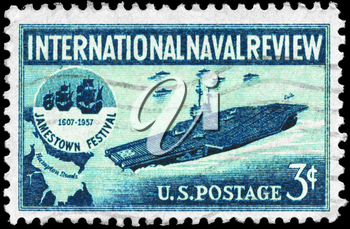 Royalty Free Photo of 1957 US Stamp Shows the Aircraft Carrier and Jamestown Festival Emblem, International Naval Review