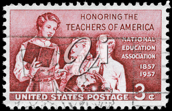 Royalty Free Photo of 1957 US Stamp Shows Teacher and Pupils, Honouring the School Teachers of America