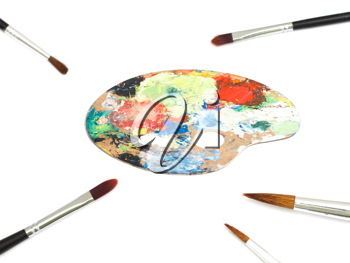 Royalty Free Photo of a Paint Palette and Paintbrushes