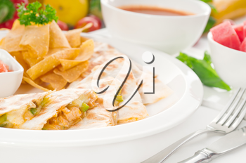 original Mexican quesadilla de pollo with nachos  served with gazpacho soup and watermelon ,with fresh vegetables on background,MORE DELICIOUS FOOD ON PORTFOLIO