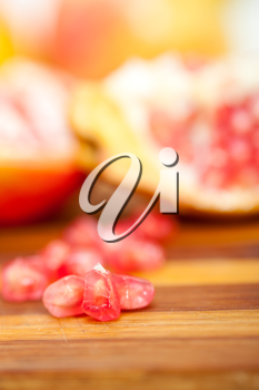 fresh pomegranate fruit over wood cutting board