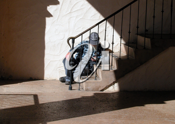 Royalty Free Photo of a Man Reading a Book on a Staircase