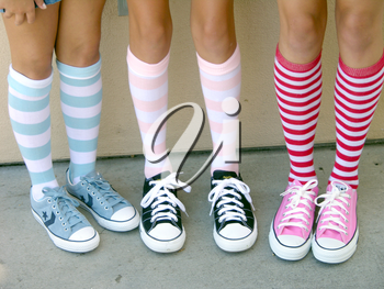 Royalty Free Photo of Girls Wearing Funky Socks