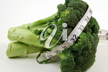 Royalty Free Photo of Broccoli and Measuring Tape