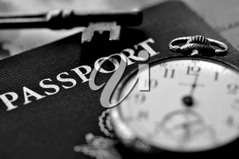 Royalty Free Photo of a Passport and Pocket Watch