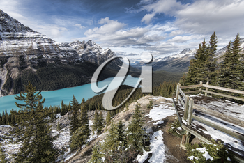Picturesque Peyto Lake, in Banff National Park. Peyto Lake (pea-toe) is a glacier-fed lake located in Banff National Park in the Canadian Rockies. The lake itself is easily accessed from the Icefields