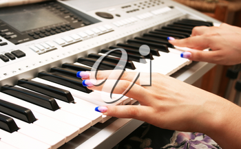 Royalty Free Photo of a Woman Playing the Keyboard