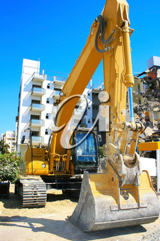 Royalty Free Photo of a Dredge Destroying a Building