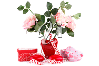 Red heart candles, roses in vase, necklace and gift boxes on white background.