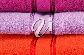 Colorful towels stack closeup picture.